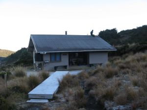 The figure on the roof is one of the boys taking down the mountain radio antenna.